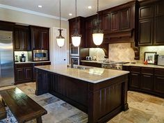 Dark Kitchen Cabinets With Stainless Steel Appliances On White