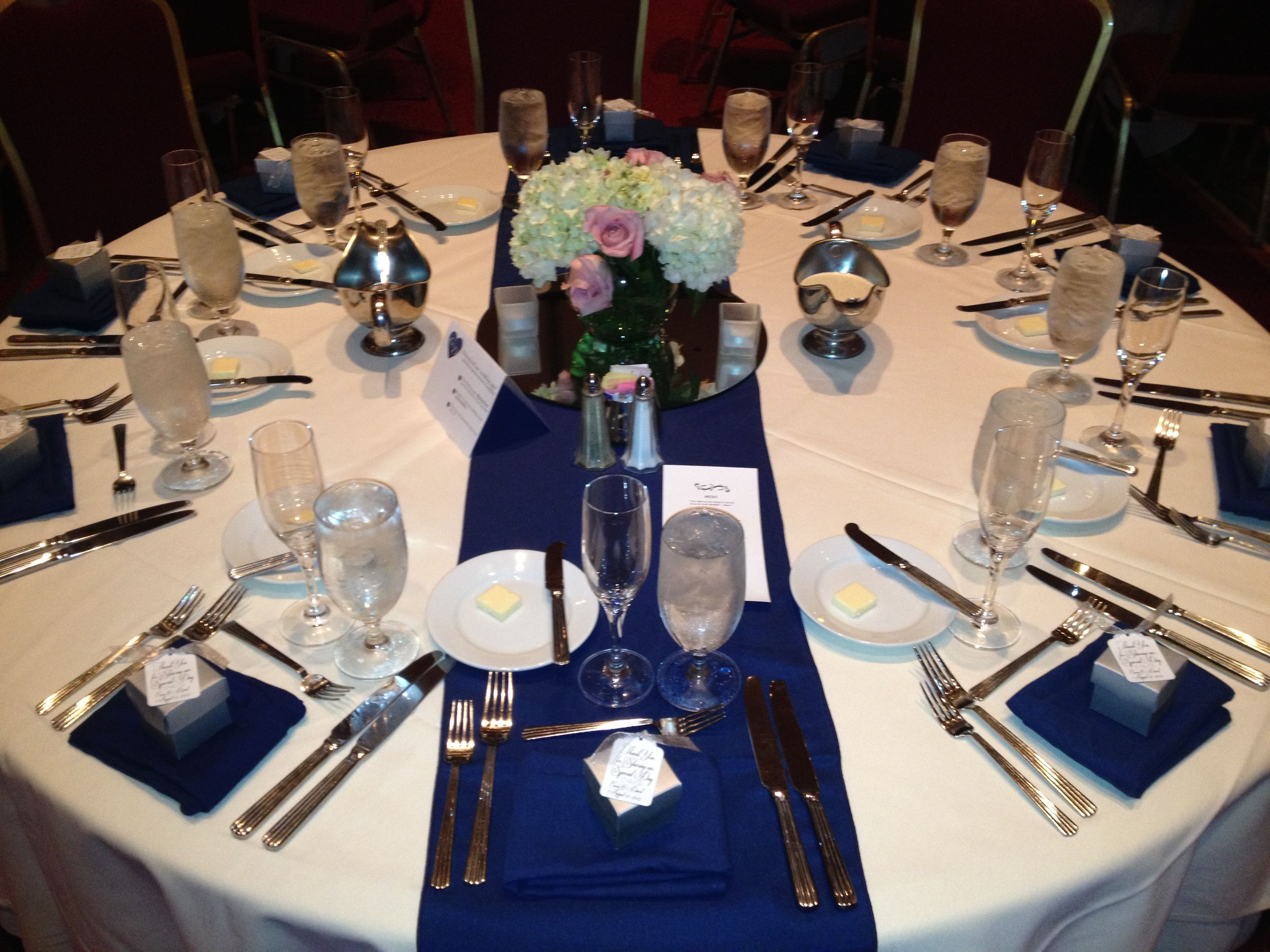 White Linen With Navy Blue Table Runner And Napkins.