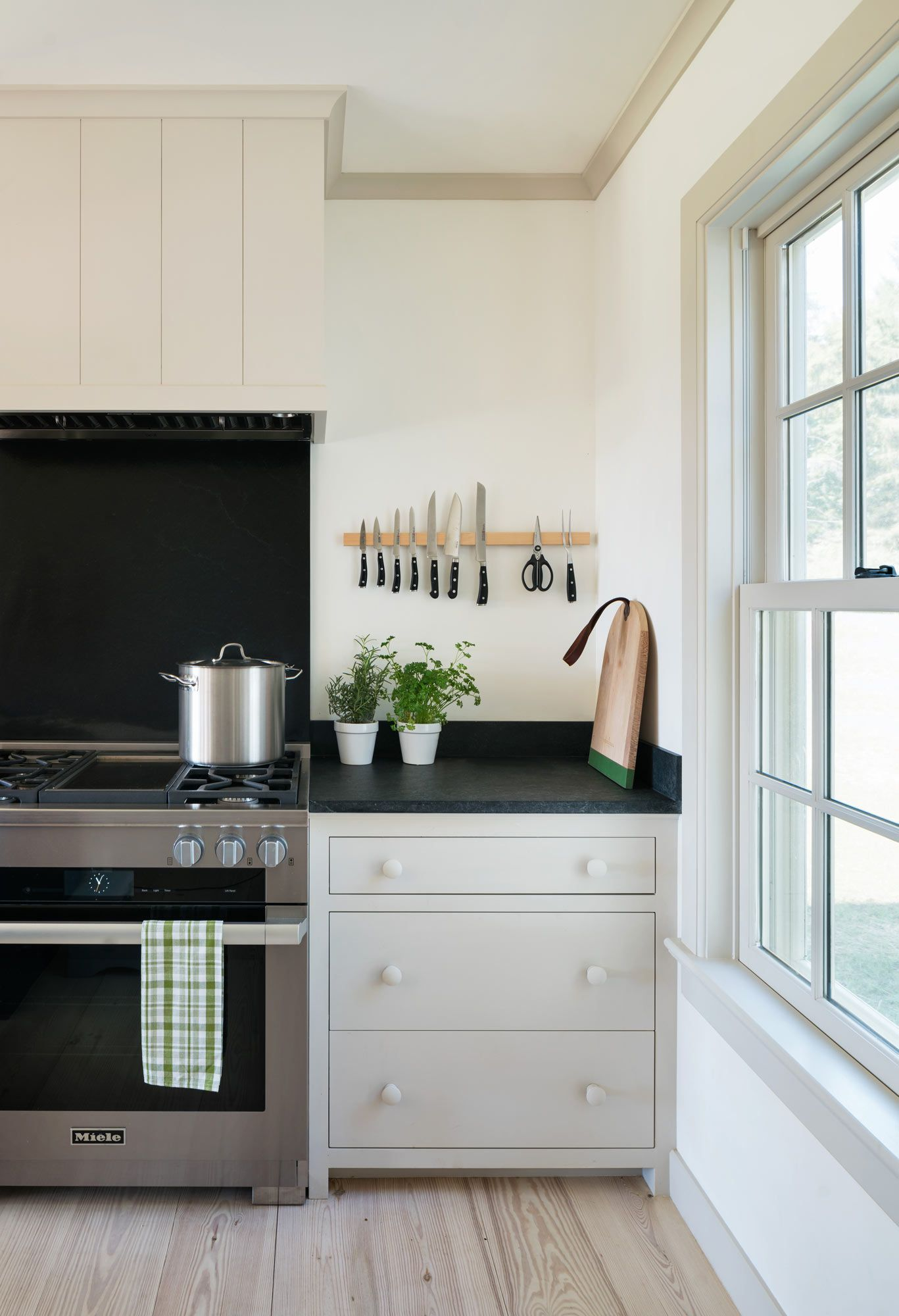 Classic white and black kitchen design with stainless steel ...