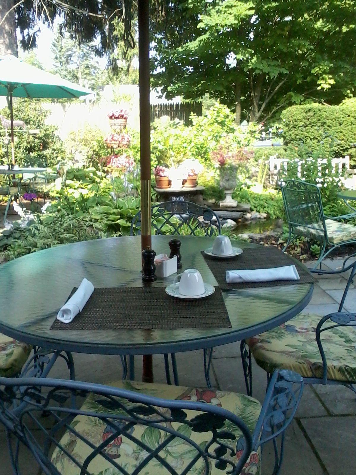 Enjoy breakfast on the terrace at The Village Inn of