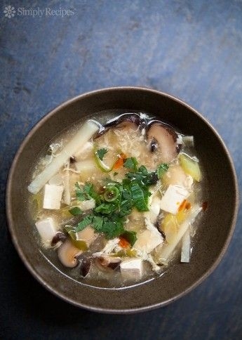 Hot and Sour Soup ~ Classic Chinese American hot and sour soup, with Chinese mushrooms, bamboo shoots, chicken broth, vinegar, tofu, chili oil, and a beaten egg. ~ SimplyRecipes.com
