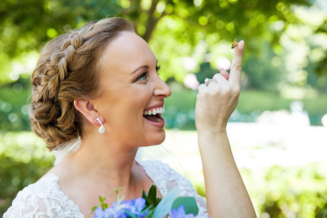 A real-life Snow White moment- a butterfly landed right on this bride's finger at Disneyland!