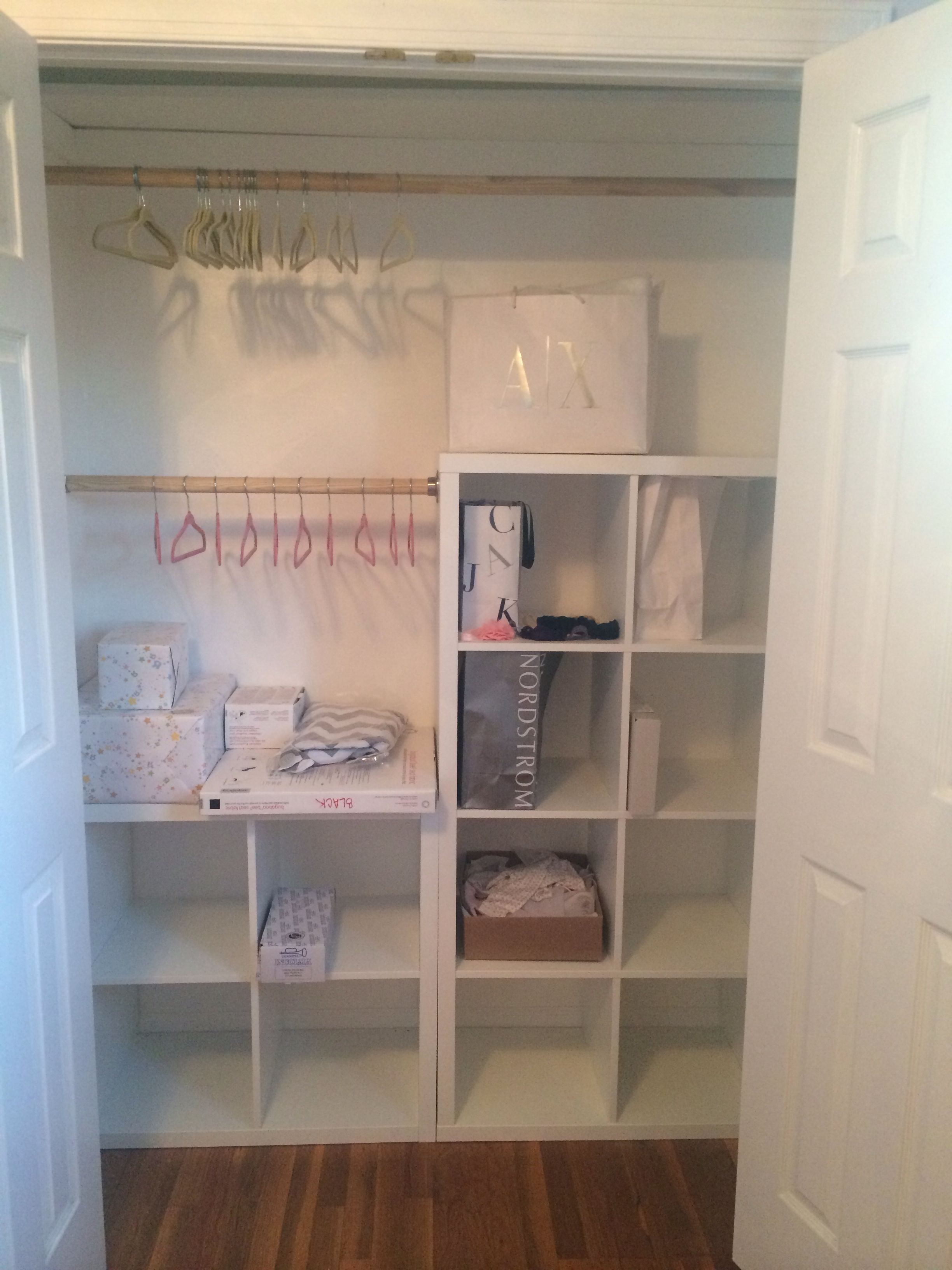 fe3ef7c28 DYI baby closet with IKEA Kallax units   wooden rods by the hubby ...