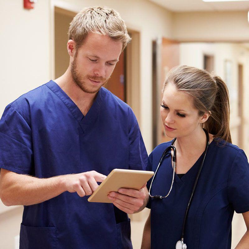 Medical Staff Looking At Digital Tablet In Hospital