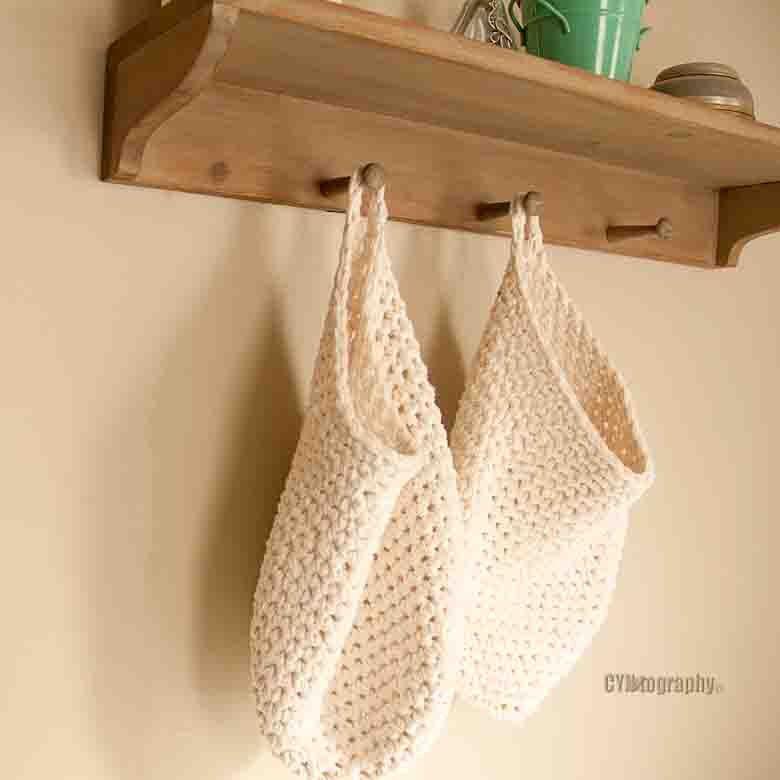 hanging storage basket, crocheted cotton by DesignsofCyn on Etsy https://www.etsy.com/listing/258880650/hanging-storage-basket-crocheted-cotton