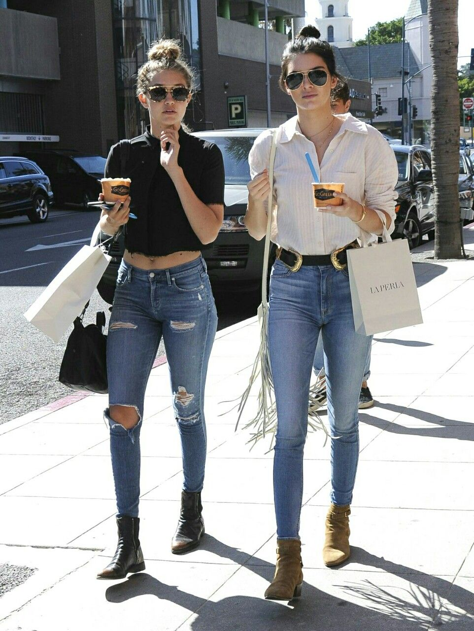 Gigi Hadid and Kendall Jenner street style - out and about shopping in plain shirts and high waisted jeans!
