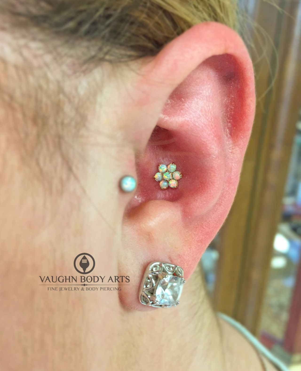 Ashley and Rainee stopped by for conch piercings the other night. Here is Ashley's ear rocking this beautiful 18k yellow gold flower with white opals, from the fine folks of anatometal.These threaded flowers are simply stunning and work so well in so many piercings. You can't go wrong with opals and gold.Thank you so much, Ashley!vaughnbodyartsMonterey, CA