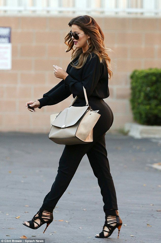 Curvaceous: Khloe showed off her svelte figure in the trousers which hugged her striking figure