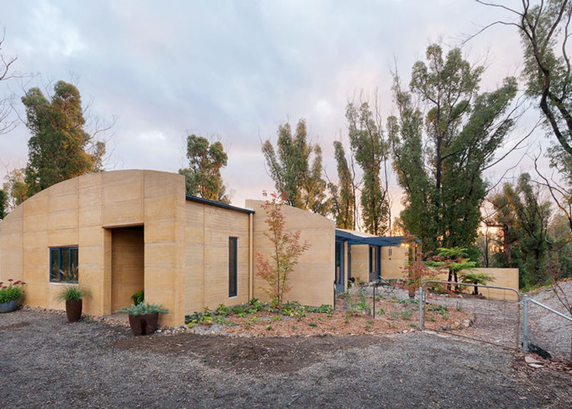 Rammed earth wall adobe building  house ideas sustainability landscaping also innovative home combines with bushfire rh pinterest