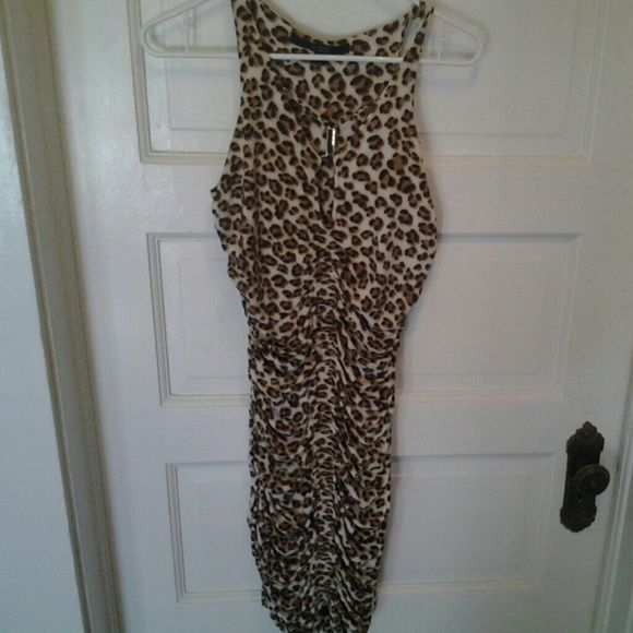 f37071f8d8 Guess leopard print dress. Worn twice. Very sexy! Keyhole Guess dress with  gold