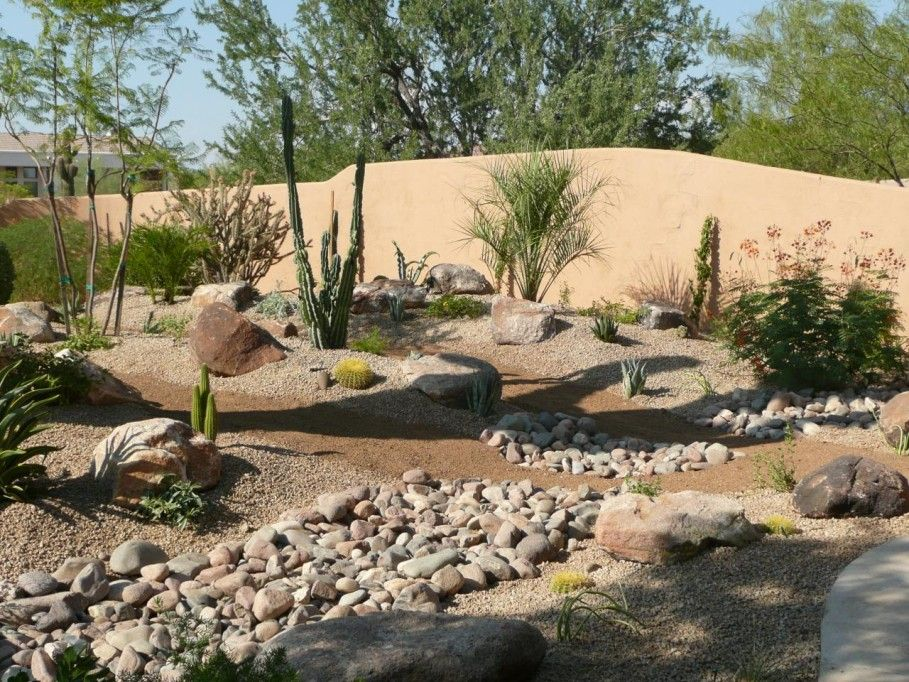 Amazing desert landscaping ideas with small plants also for Smooth stones for landscaping