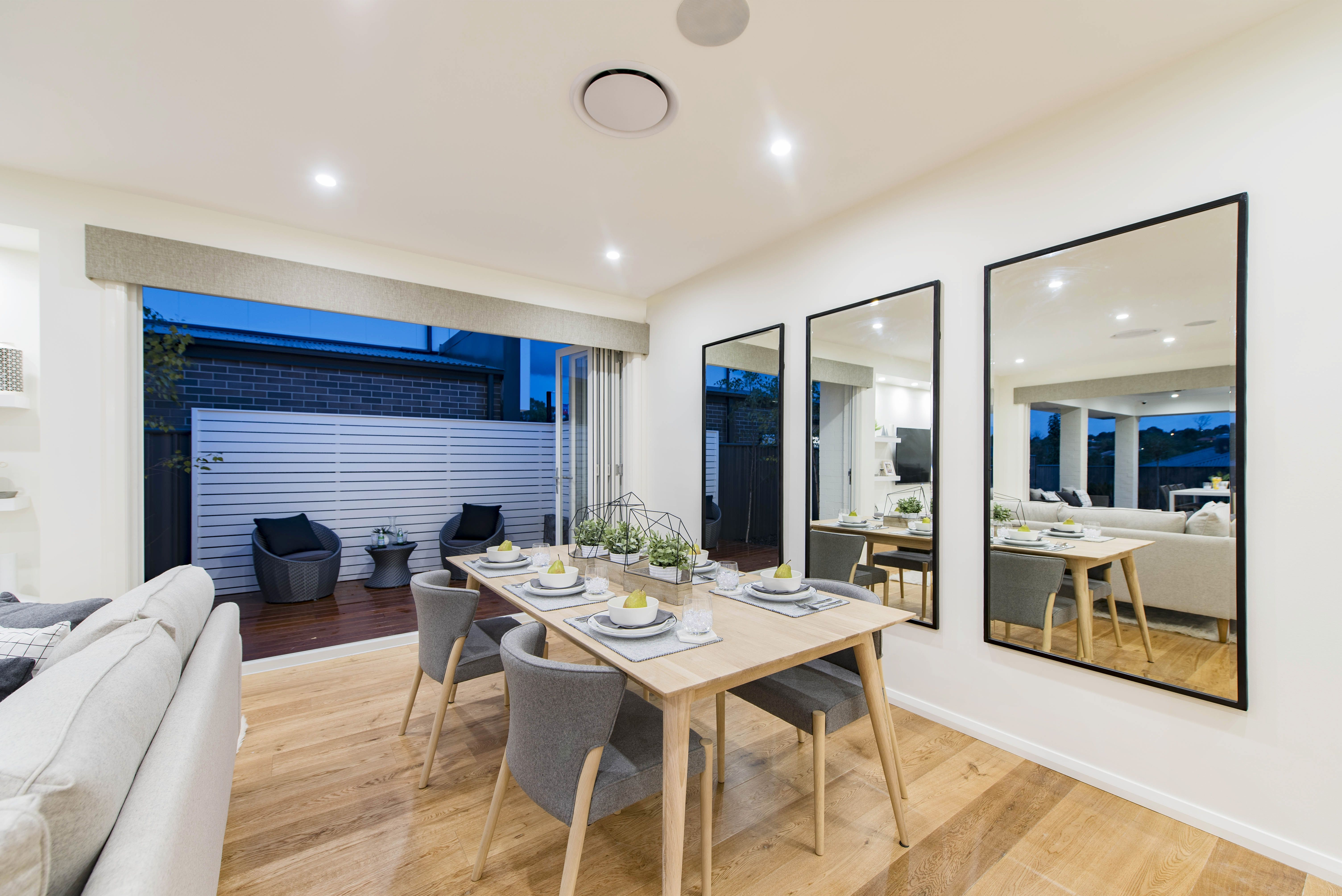 The beautiful #dining space in the Stoneleigh on display in Moncrieff, featuring a #Scandinavian #interior #style. For details and more photos see http://mcdonaldjoneshomes.com.au/display-home-locations/moncrieff. #scandi #mirrors #diningtable #alfresco #indooroutdoor #living #chairs #furniture #interiordesign #interiorstyle #décor #decorate #home #newhome