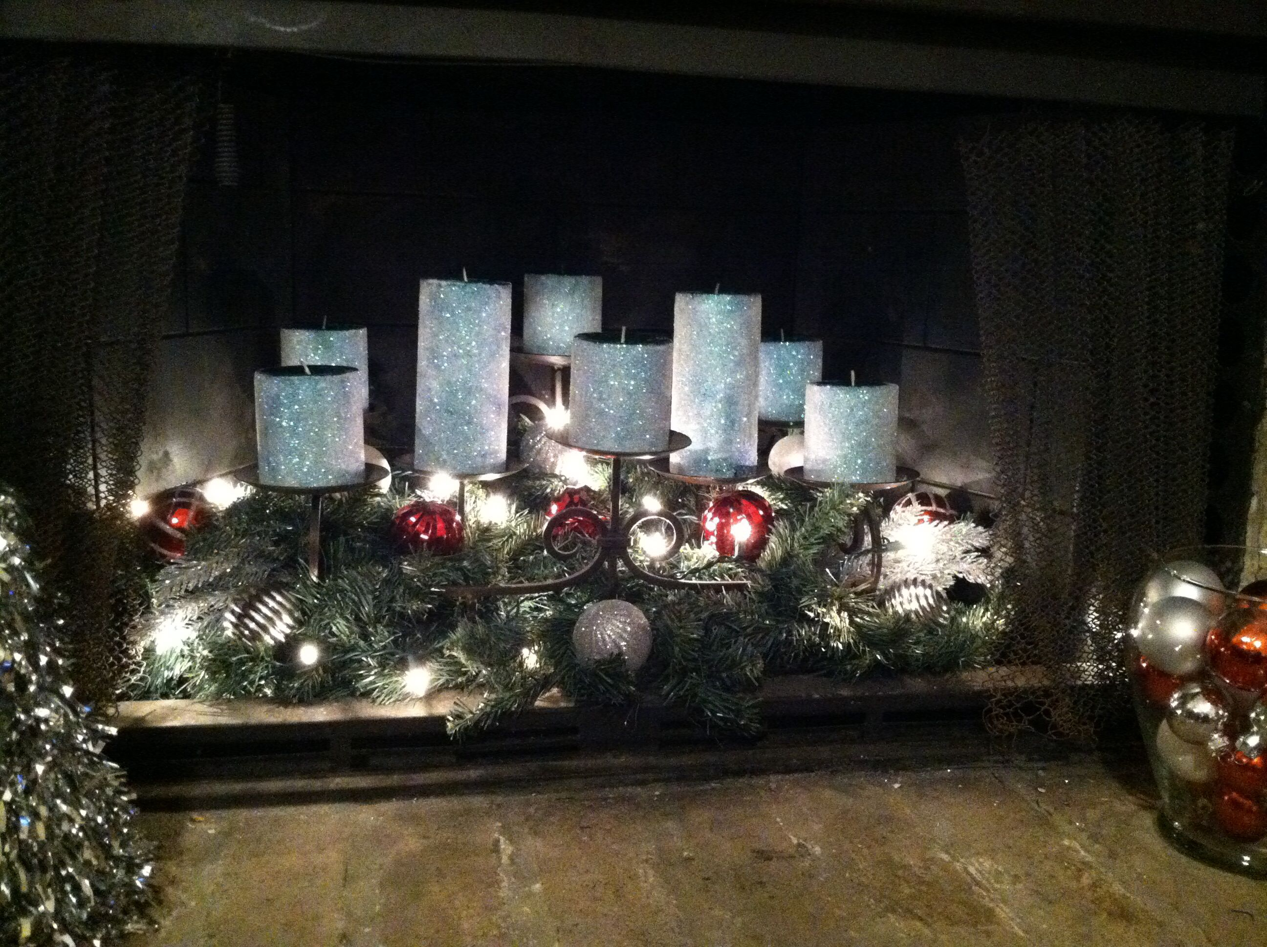 i added lights garland and ornaments to our non working fireplace