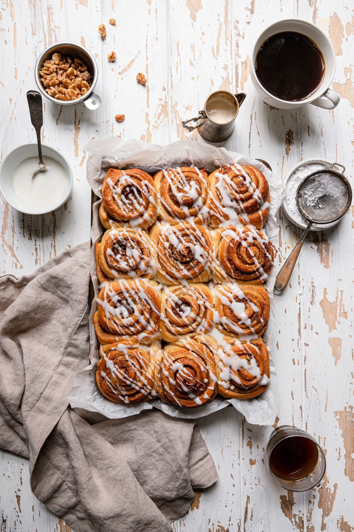 These bakery-style Cinnamon Rolls are fluffy, tender, and the kind of pastry that makes you smack your tough and mouth without even noticing. And yes, the sticky brown sugar cinnamon filling will absolutely fill your home with a warm comforting aroma.  #cinnamonrollsrecipe #bakerycinnamonrolls #easycinnamonrolls #homemadecinnamonrolls #baking #cinnamonrollsphotography #foodphotography #howtomakecinnamonrolls #cinnamonpastry #brunchrecipe #breakfastrecipe #breakfastidea #breakfastpastry 