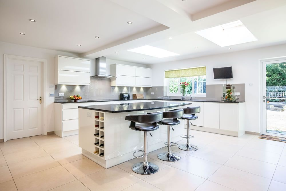 White Kitchen Extensions a spacious, white, contemporary kitchen with large skylights