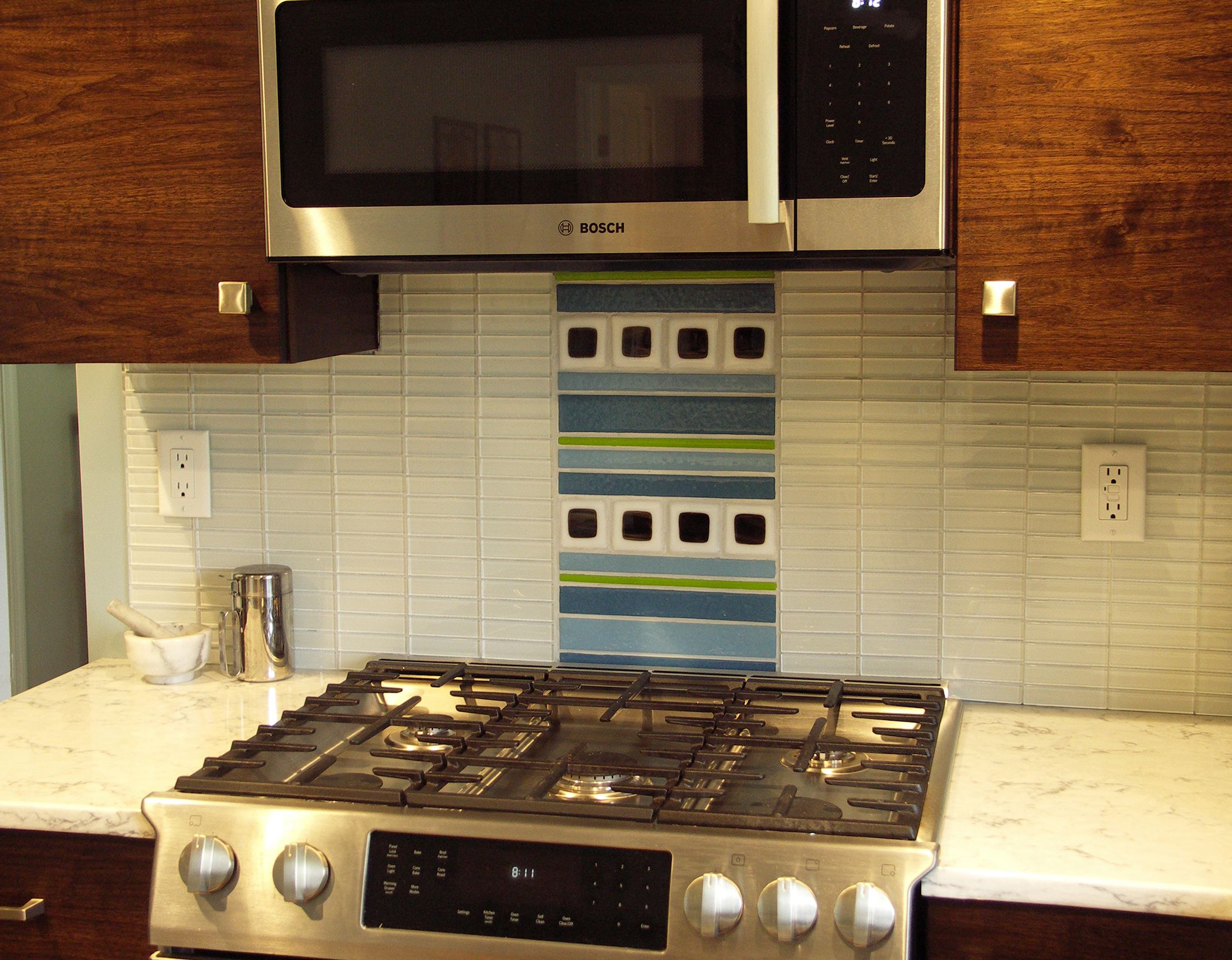 Kitchen remodel using white glass 1x4 subway tile backsplash with kitchen remodel using white glass 1x4 subway tile backsplash with a decorative center tile over stove doublecrazyfo Gallery