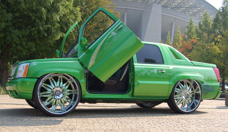 Green Cadillac Avalanche Sitting On 22 Inch Rims Cars And