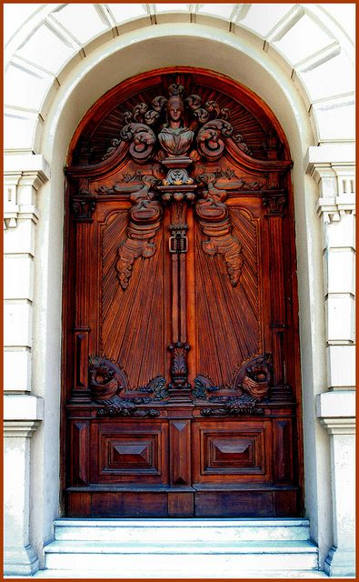 Heavily carved wooden door..Brought to you by Cookies In Bloom and on