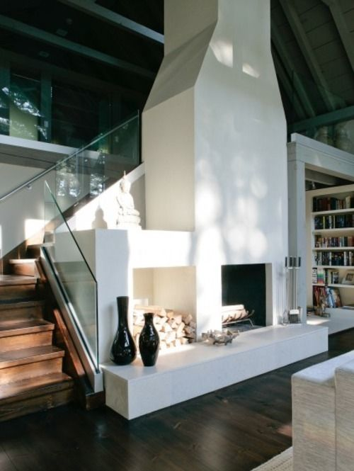 Stucco Fireplace And Nice Glass Stair Rail