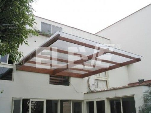 Alero marquesina en voladizo madera y vidrio vivienda for Viviendas sobre terrazas