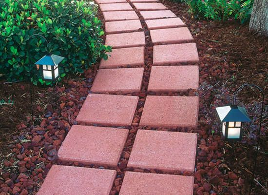 Lava rock and brick pavers make a nice garden walkway for Lava rock pavers