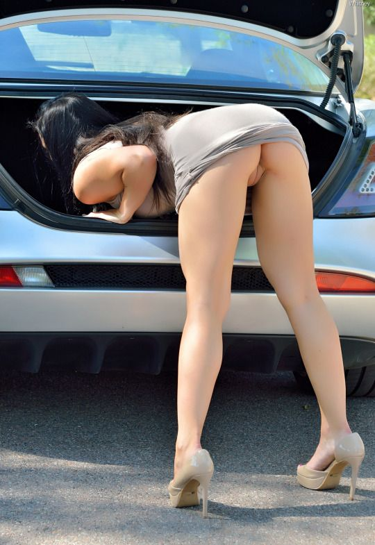 Girl bent over public