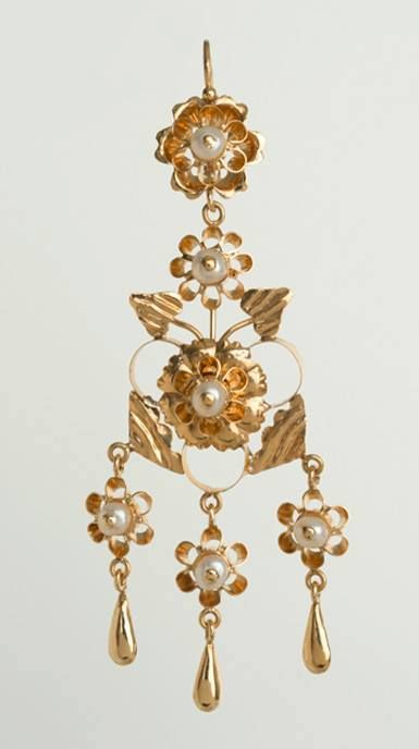 A classic #Spanish style, this is one of our most elaborate pieces. More than 170 separate repoussé and fabricated pieces of 18kt gold make up a single pair of these earrings. Set with white freshwater pearls, these are truly heirlooms for future generations. #HandmadeJewelry http://bit.ly/1syOs7L