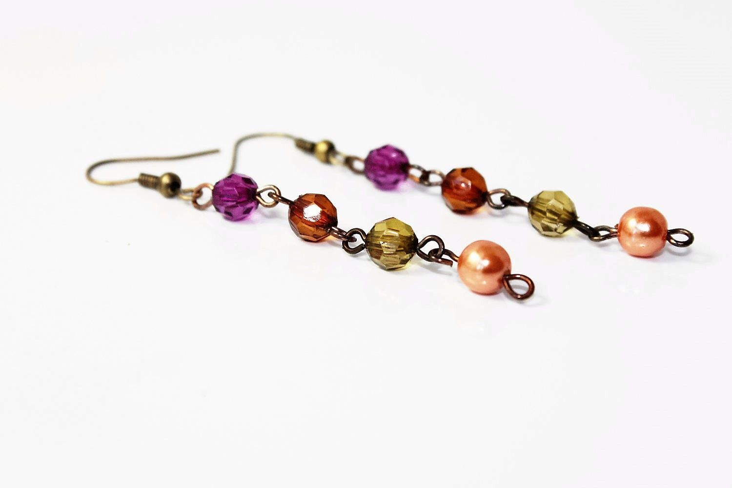 Purple, Orange, and Green Glass Wire Wrapped Beaded Dangle Earrings by MarmeliDesigns on Etsy https://www.etsy.com/listing/107330784/pay-only-shipping-purple-orange-and