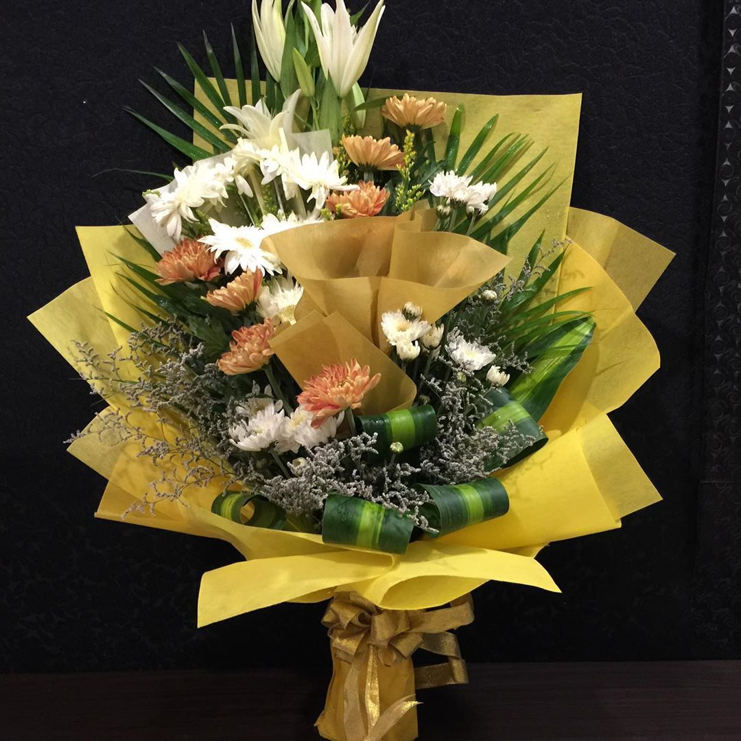 Chrysanthemum and Lilies flower bouquet delivered near an