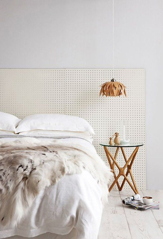 Pegboard headboard. We are not keeping a lot of furniture, but we're keeping the bed, which has no headboard but lots of storage underneath. I love this solution.