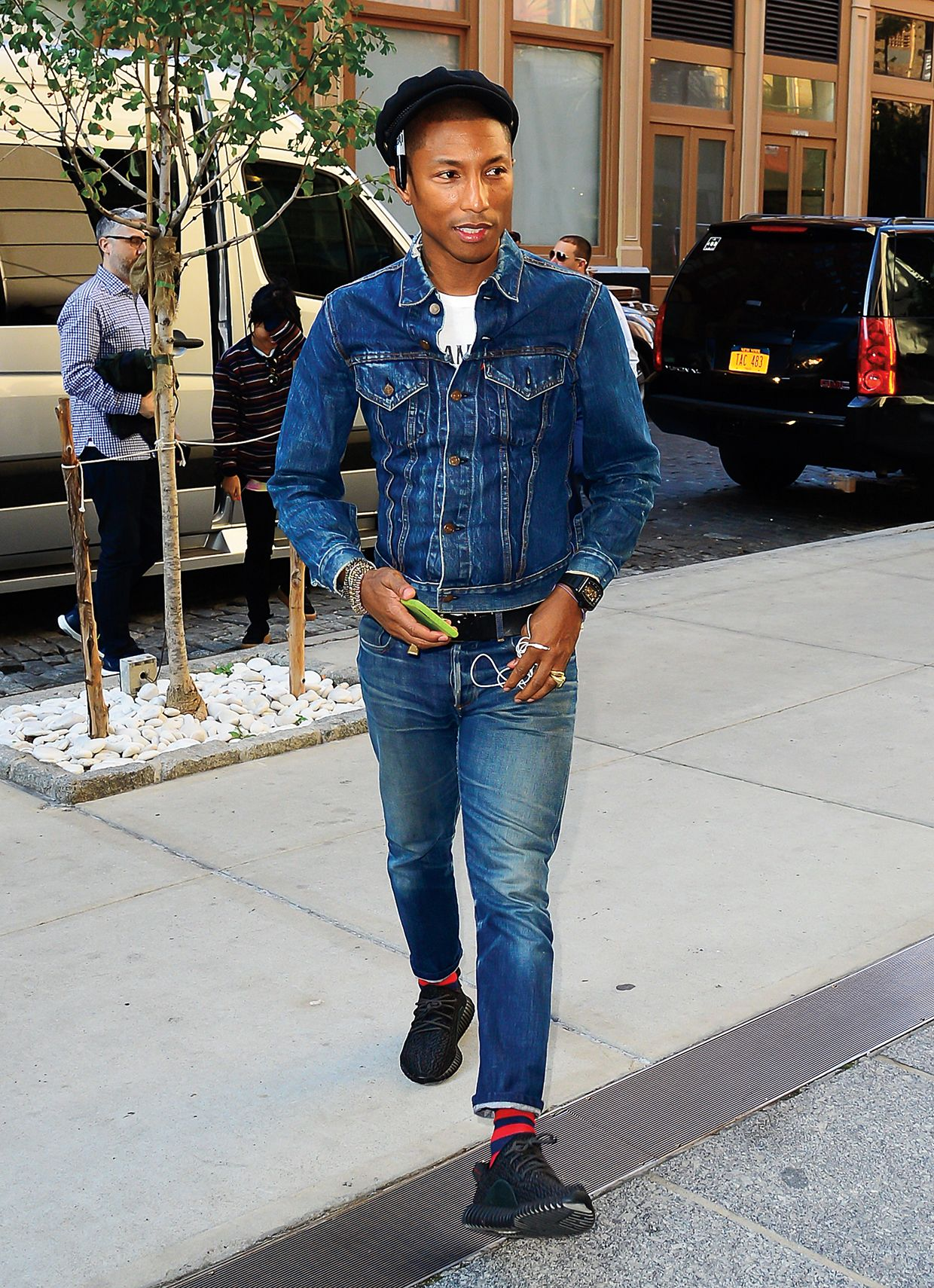 eb9d93b3f16 Pharrell Williams wears a dark denim Levi s Trucker Jacket and jeans
