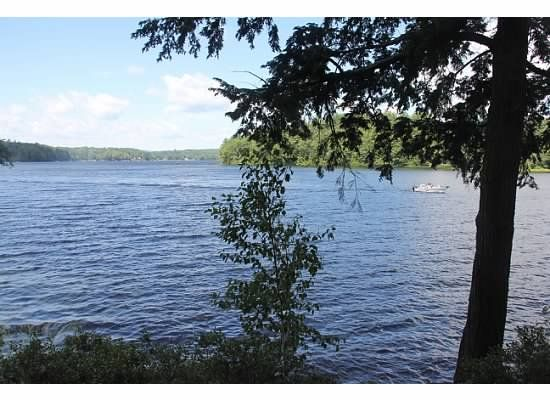 Half Moon Lake sits right outside your window!  #NHvacation #FernhillCottages