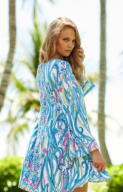 430828a5ff This fun print on our Lilly Pulitzer Colette Tunic Dress paired with gold  wedges is sure to make a splash!