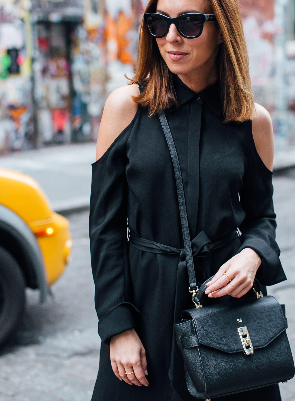 Sydne Style wears Henri Bendel monogrammed black bag for office outfit ideas