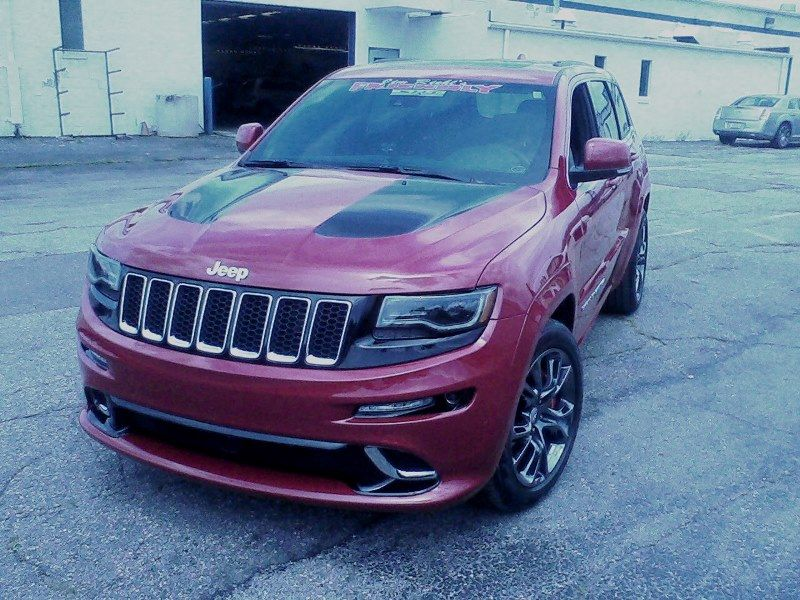 Custom Gloss Black Rally Stripes Installed On A Maroon Srt8 Jeep