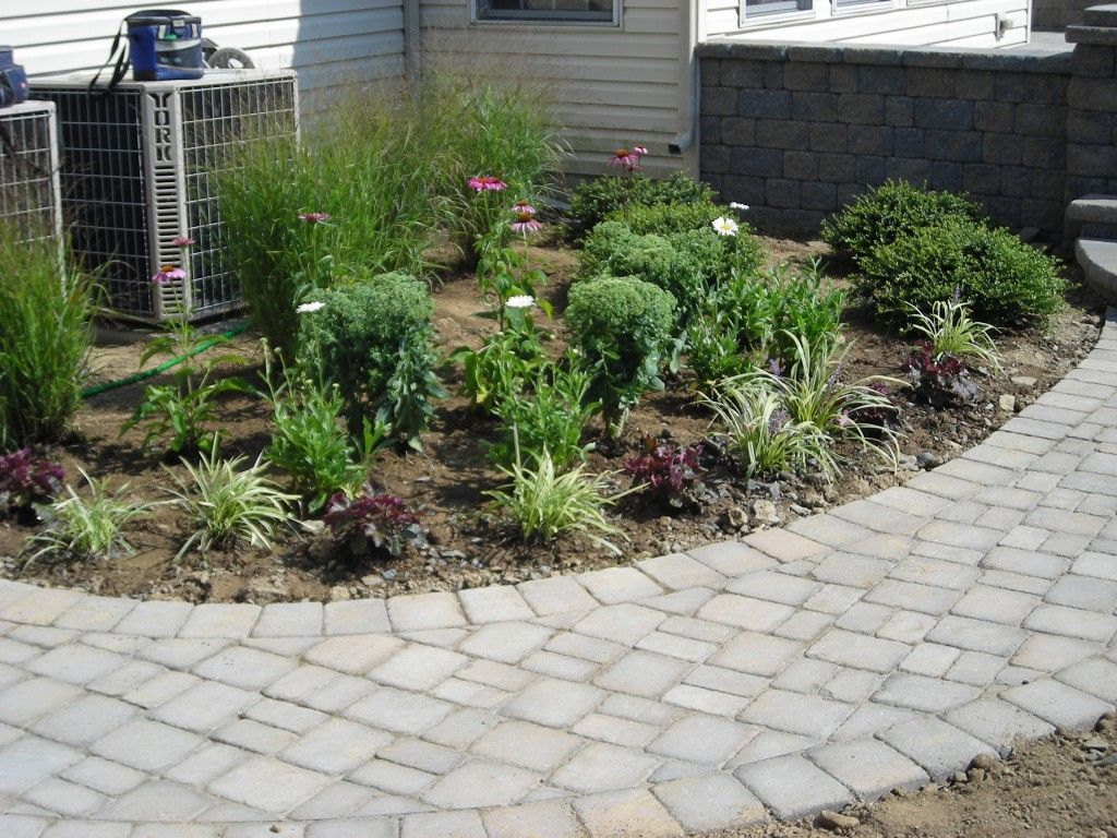 Superb Landscape Bed Used To Hide A/C Units And Accent Walkway To Back Patio