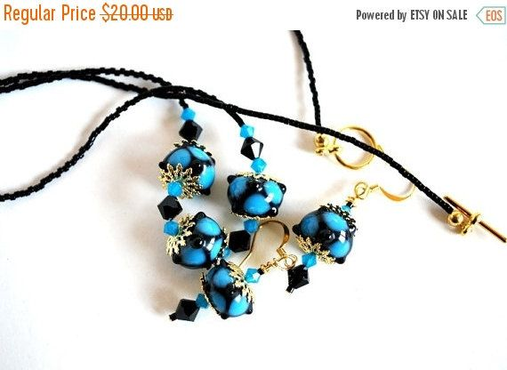 On #Sale Teal Dots on Black Bead #Necklace and by #polymerclaybeads @julielcleveland
