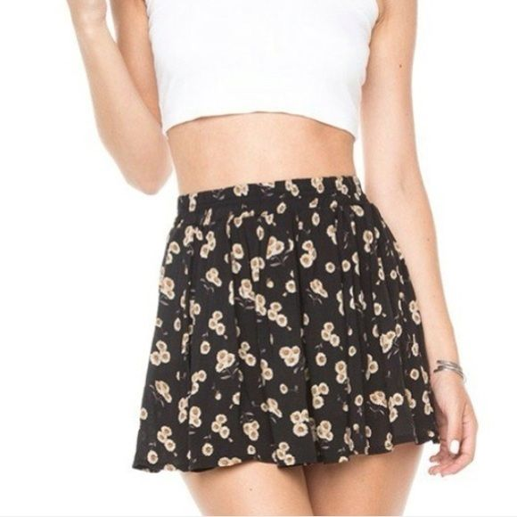 Brandy Melville Daisy Skirt So cute and comfy! Fits size xs to small. New, never worn! No trades. Free Brandy sticker with purchase. Brandy Melville Skirts Mini