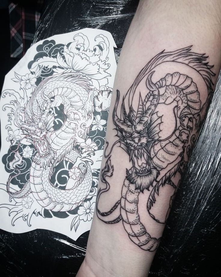 Dragon tattoo on forearm blackwork by Larisa Chuprina