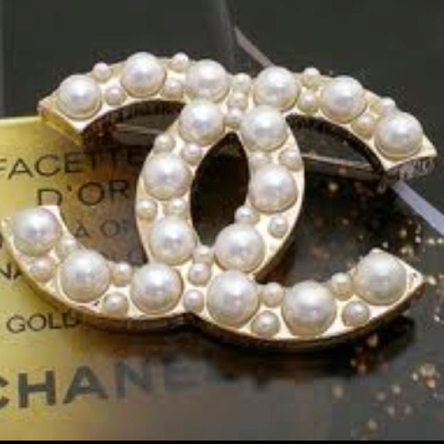 Gotta love Coco and her Chanel brooch ♥