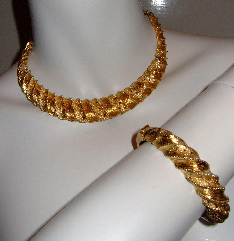Vintage 1980's Gold Tone Chunky Metal Twist Effect Necklace & Bangle by MondoTrashoVintage on Etsy