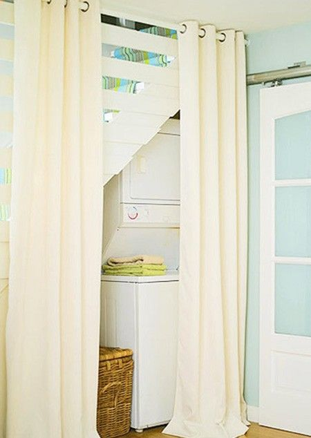 Stack Laundry Under Staircase With Curtain Wall Laundry Room