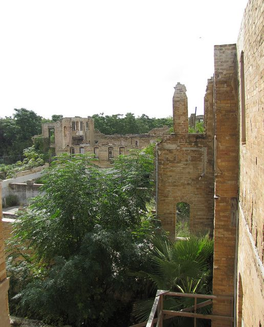 It's a hot day and there isn't a breath of cooling wind among the ruins of the Hot Wells bath house in San Antonio, Tx