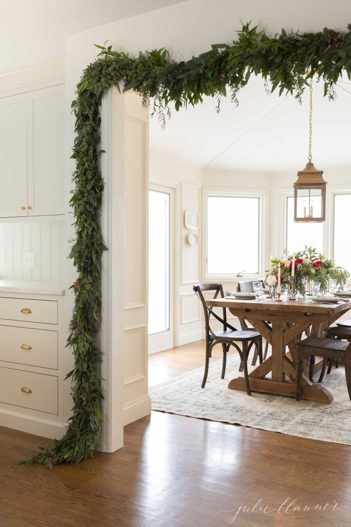 traditional home decorated for christmas with garlands and flowers #christmasdecor #christmasdecorating #christmasflowers