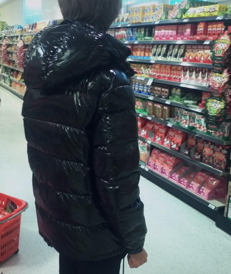 6a2203d64021 Asian lad in a supermarket - wearing a shiny black Moncler Maya down jacket.