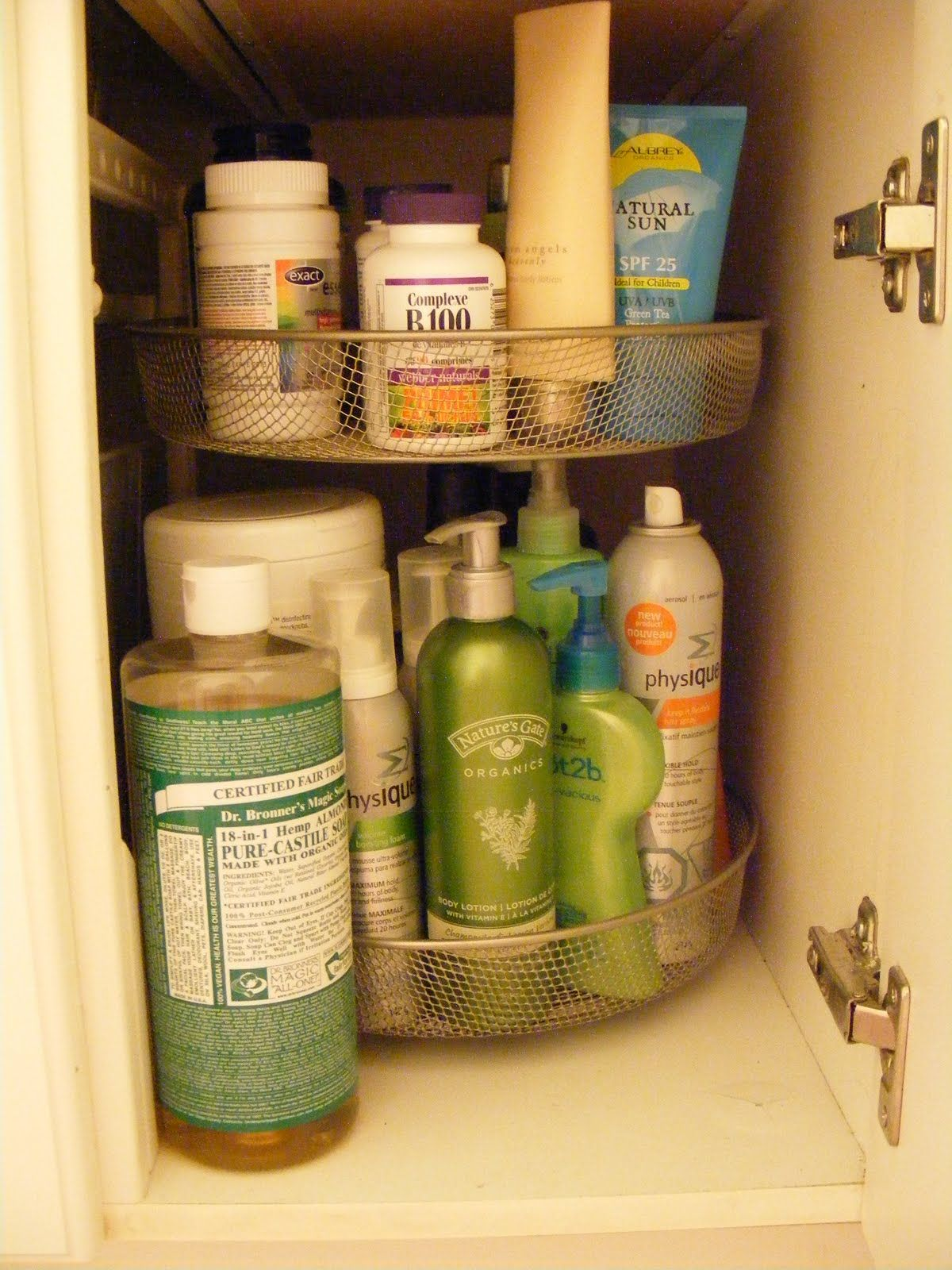 Use A Lazy Susan Under The Bathroom Sink For Organizing Bath Body Products