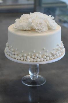 White Single Layer Cake With Florals On Top Amp Pearl Accents