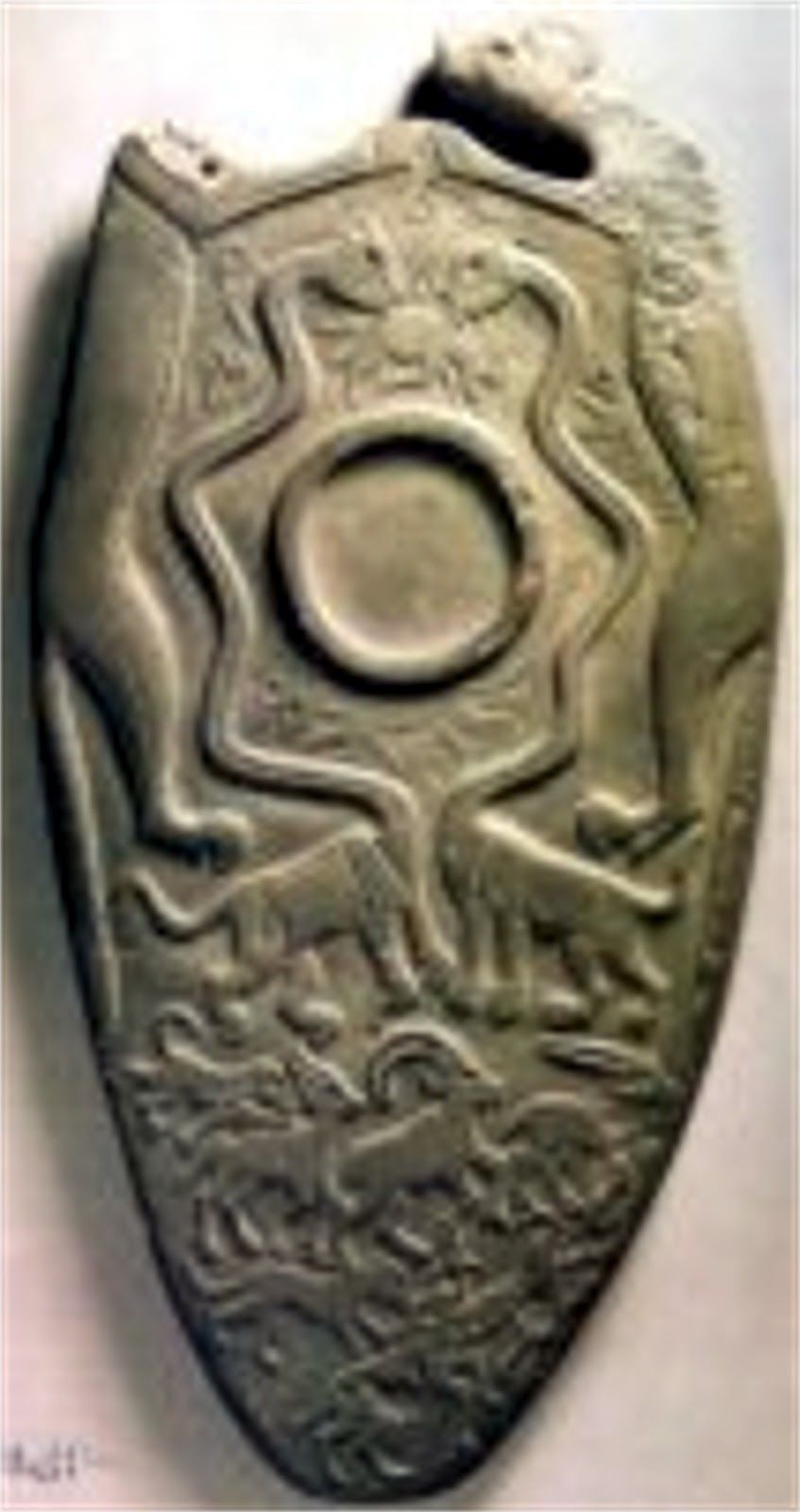 Ancient carvings of dinosaurs different palette same