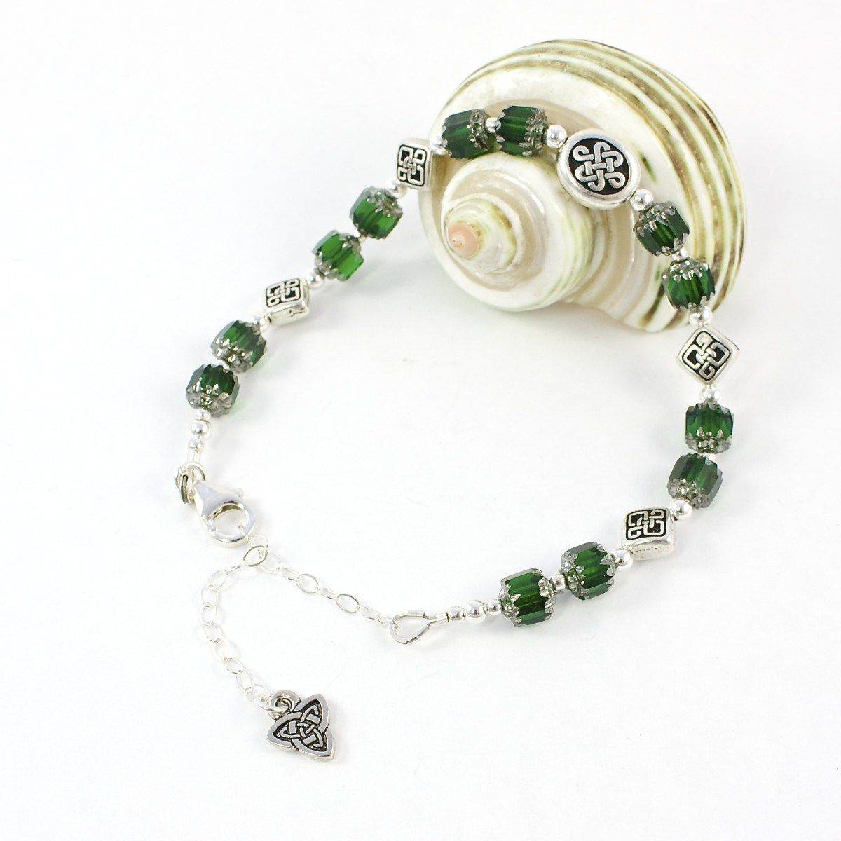 """Celtic Knot Bracelet #Handmade by @solanakaidesign -- from listing:  """"This Celtic knot bracelet features fine silver plated Celtic knot beads, emerald green Czech glass cathedral beads and sterling silver beads ..."""""""