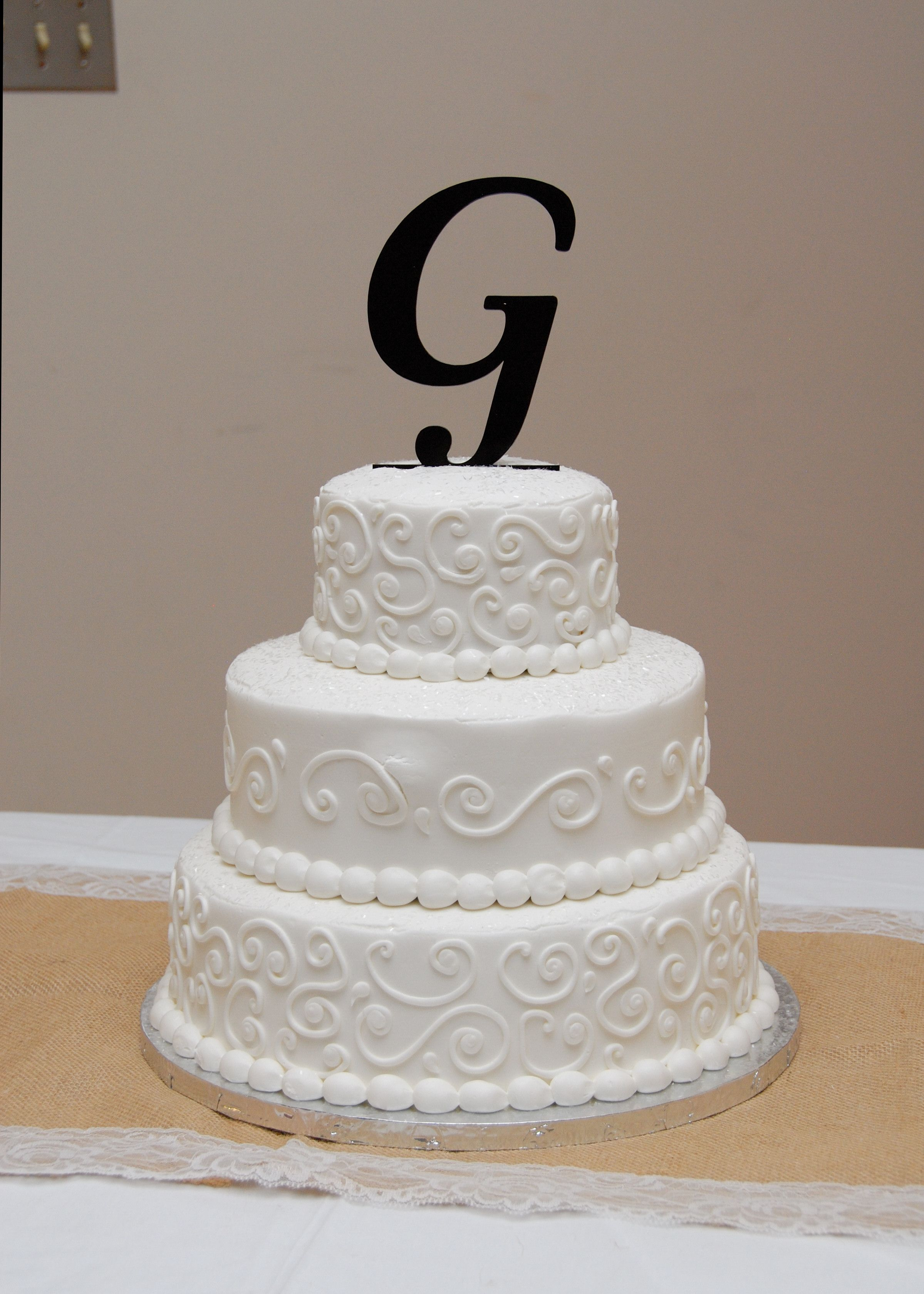 My wedding cake, made at Walmart, was almost hesitant to